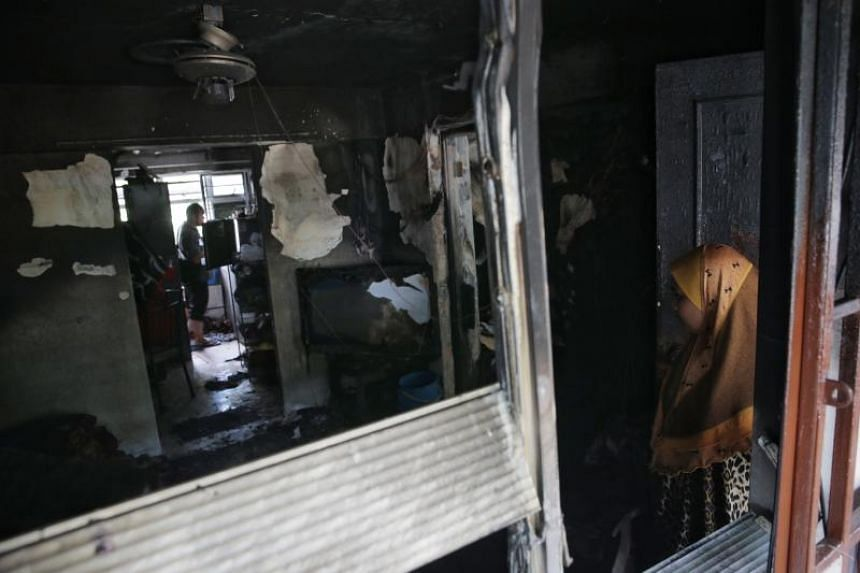 The aftermath of the fire that took place on July 15 at Block 191 Boon Lay Drive.