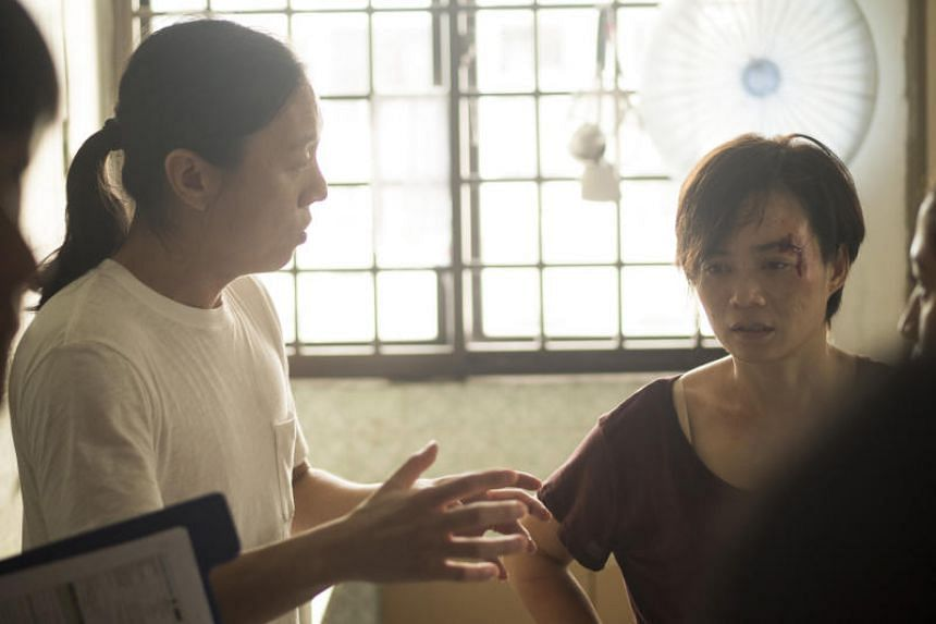 A still from an episode of the HBO series Invisible Stories, featuring Yeo Yann Yann (right) and director Ler Jiyuan.