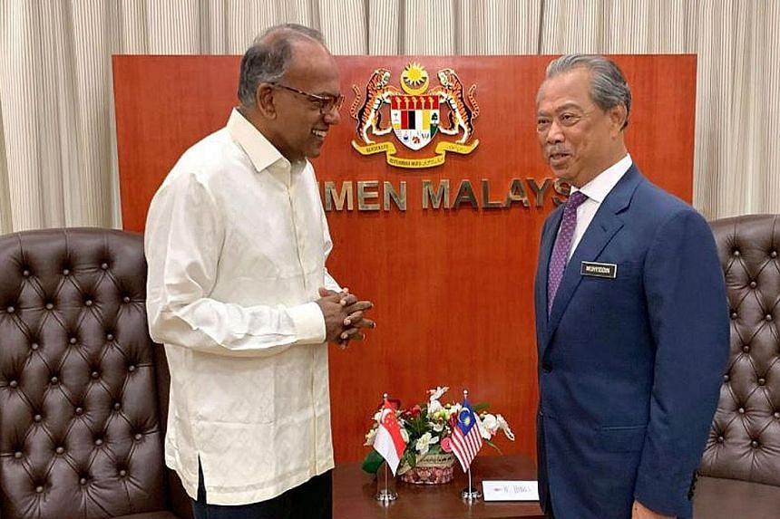 Singapore's Home Affairs Minister K. Shanmugam (far left) with his Malaysian counterpart Muhyiddin Yassin in Kuala Lumpur yesterday. PHOTO: K. SHANMUGAM/ FACEBOOK