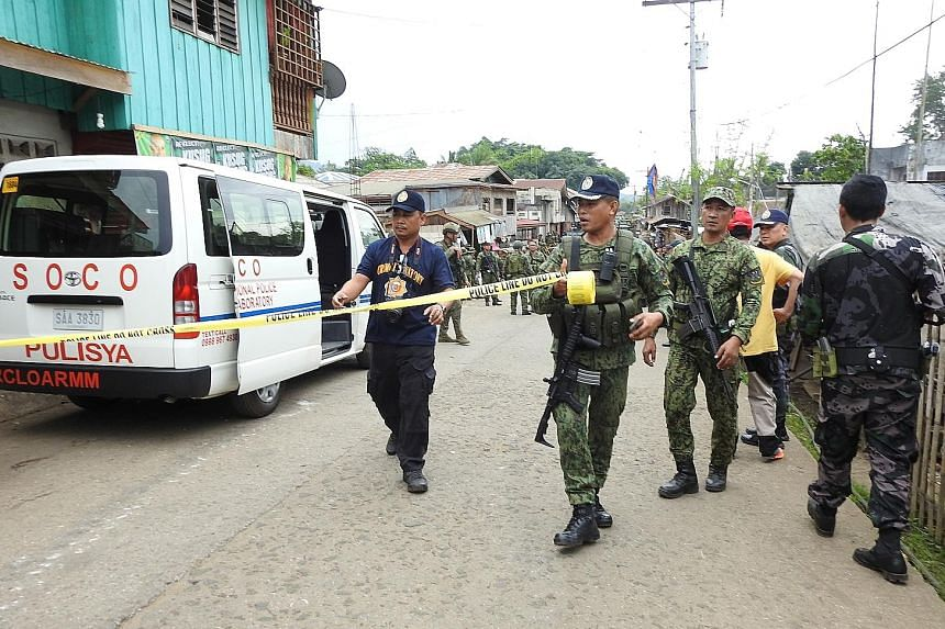 Security forces cordoning off an area after last month's attack inside a temporary camp of a special army counter-terrorism unit on Jolo island in the Philippines. It is the first-ever suicide attack carried out by a Filipino.