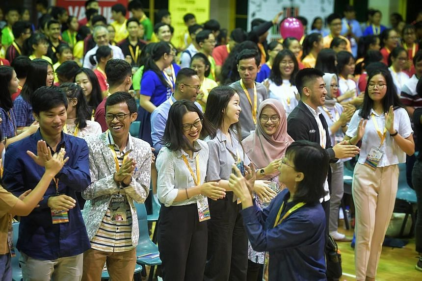 Above: Asean youth delegates and local student leaders attending the 11th Global Youth Leaders' Summit at Yio Chu Kang Secondary School yesterday. Left: Top voice artist Pocholo Gonzales spoke to the students yesterday.