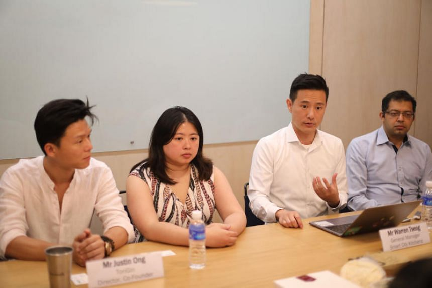 Mr Warren Tseng (second from right), general manager of Smart City Kitchens, speaking at a press conference on July 17, 2019.