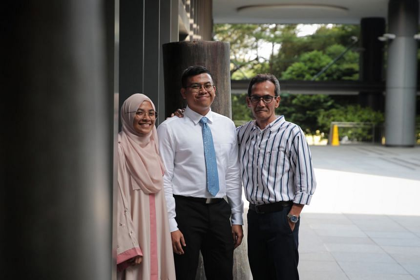 PSC scholarship recipient Mr Zulhaqem Zulkifli with his father, retired cleaner Mr Zulkifli Atnawi, 59, at the scholarship ceremony in Parkroyal Hotel in Beach Road. With them is Mr Zulhaqem's sister, Zulayqha Zulkifli, 25, who was a The Straits Time