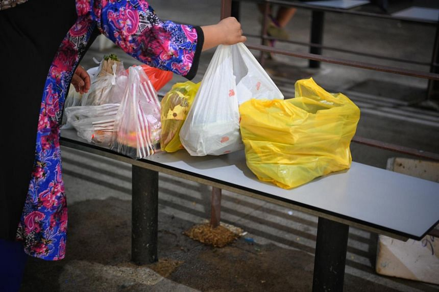 A customer with several plastic shopping bags.