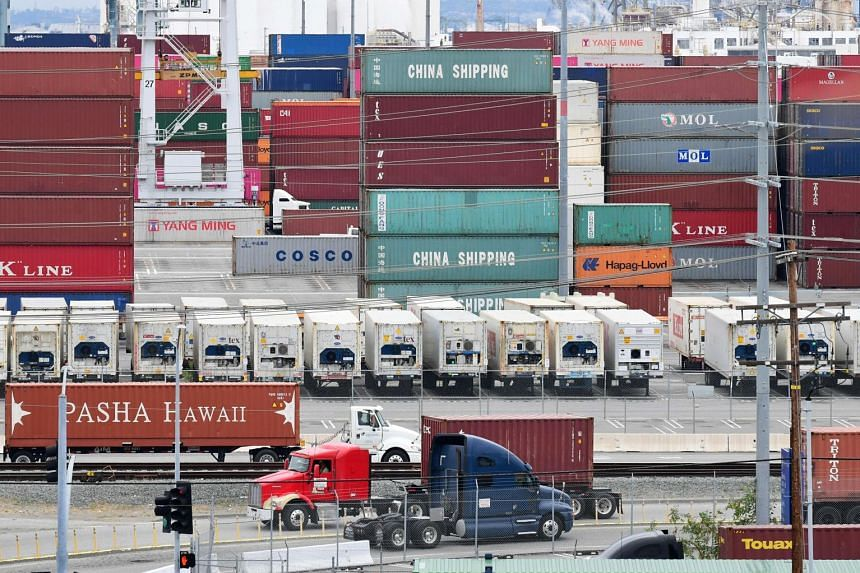Containers trucks arriving in June 2019 at the Port of Los Angeles, where the US-China trade war created logistical havoc following a months-long surge of imports in anticipation of higher tariffs.