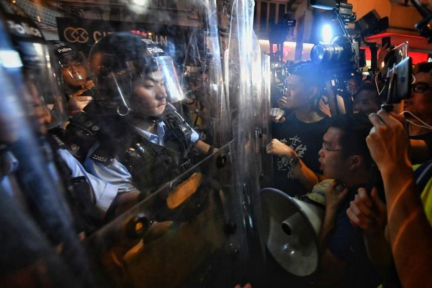 As the street-level face of the government during protests, police say they are easy targets for public rage.