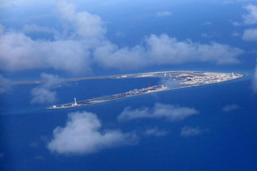 """The Subi reef, one of several islands in the South China Sea claimed by China. China's U-shaped """"nine-dash line"""" marks a vast expanse of the South China Sea that it claims, including large swathes of Vietnam's continental shelf where it has awarded"""