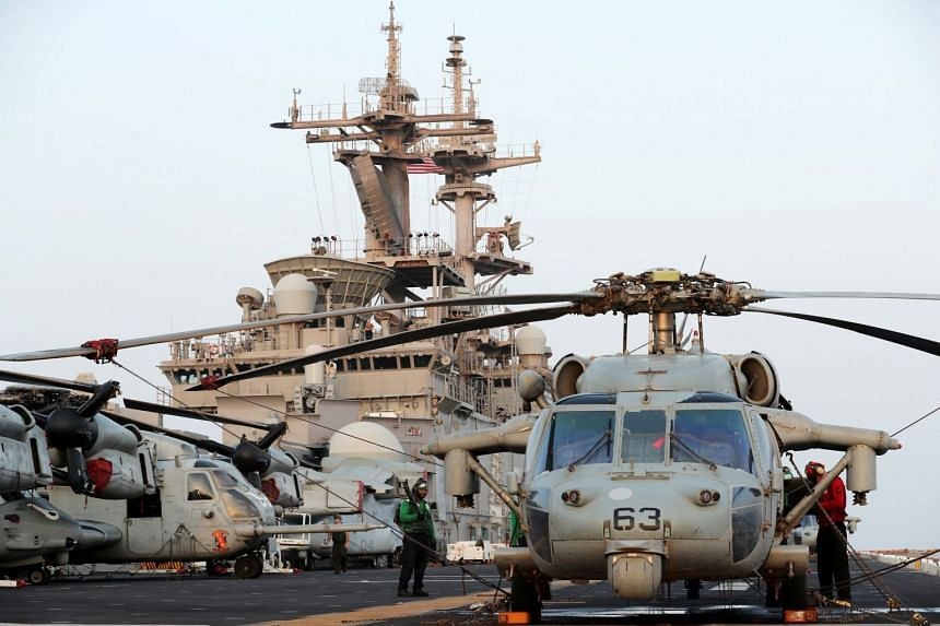 A general view of aircraft on the flight deck of the USS Boxer.