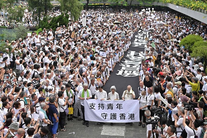 A group of elderly protesters marching to the government headquarters yesterday in the latest rally against the extradition Bill. PHOTO: AGENCE FRANCE-PRESSE