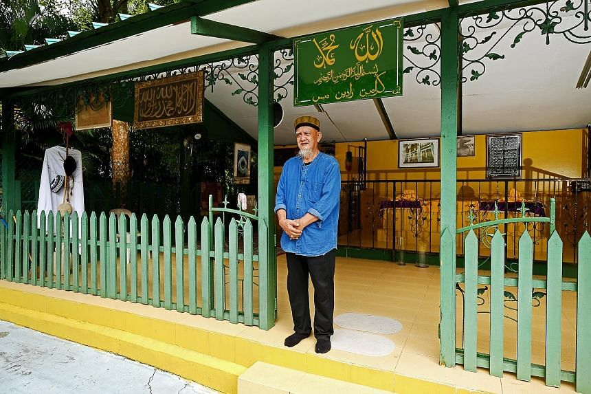 Retiree Zainal Angus at the hut where he tends the tomb of Radin Mas Ayu - a Javanese princess who was killed while trying to shield her father, according to folklore.