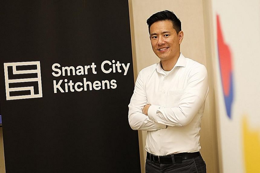 Mr Warren Tseng, general manager of Smart City Kitchens, says Deliveroo and GrabFood have refused to list restaurants operating out of its kitchen on their platforms. The shared kitchen operator estimates the two companies represent about 60 per cent