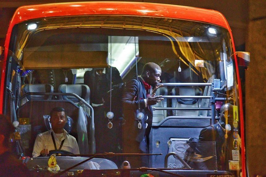 Manchester United player Paul Pogba alighting a bus to cheering fans on July 18, 2019. Manchester United will be playing at the International Champions Cup this weekend.