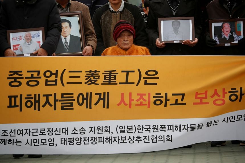 Kim Seong-ju, a victim of wartime forced labour during the Japanese colonial period, arrives with relatives of other victims in front of the Supreme Court in Seoul, in 2018.