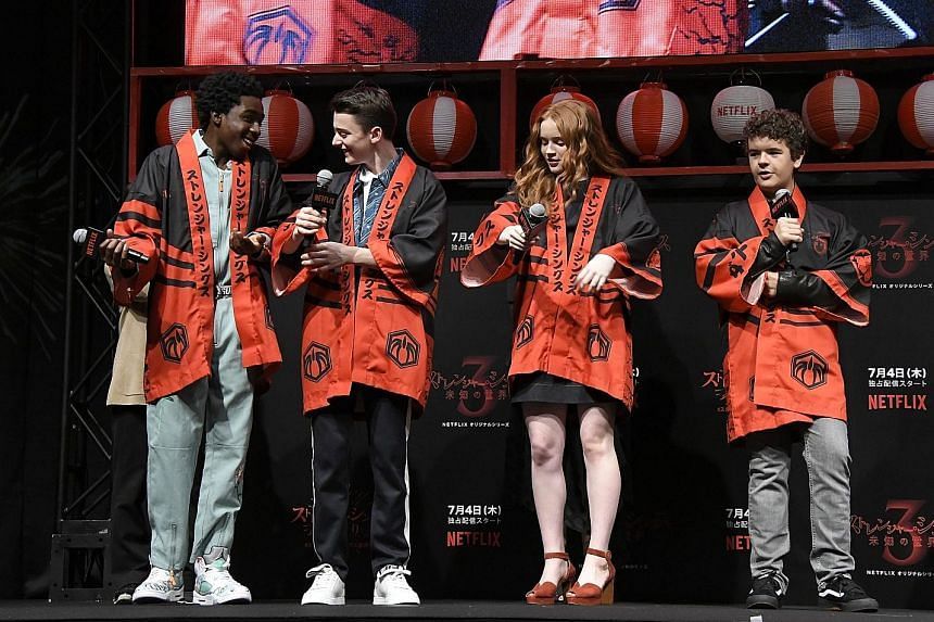 The cast of Netflix original drama Stranger Things - (from far left) Caleb McLaughlin, Noah Schnapp, Sadie Sink and Gaten Matarazzo - in specially made traditional Japanese festival coats at a fan event in Tokyo this month. Looking ahead, Netflix pro