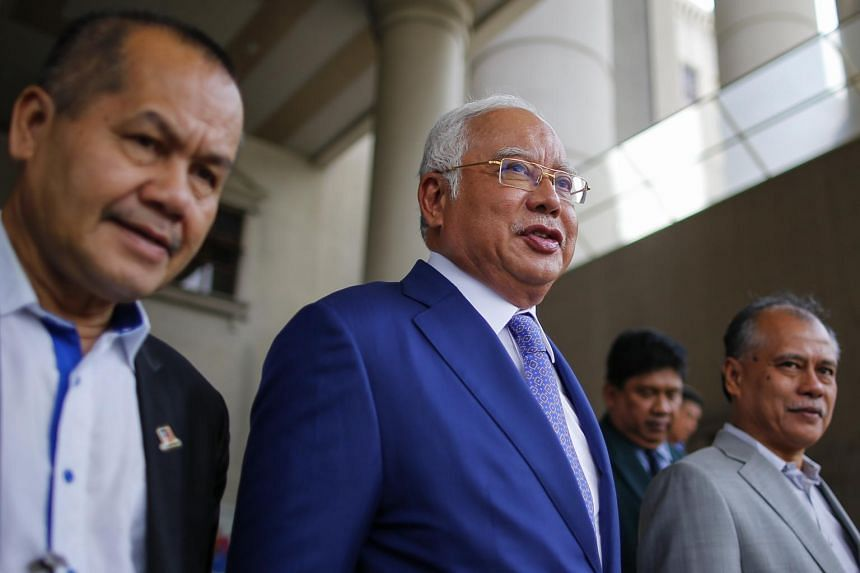 The 1MDB scandal - allegedly involving Malaysia's former leader Najib Razak (centre), his family members and inner circle - played a key role in the defeat of his long-ruling coalition at the polls last year.