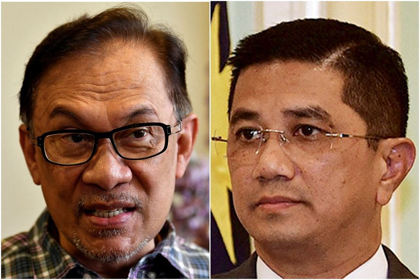 PKR president Anwar Ibrahim (left) has denied involvement in masterminding the clips. Economic Affairs Minister Azmin Ali has denied being in the gay sex videos.