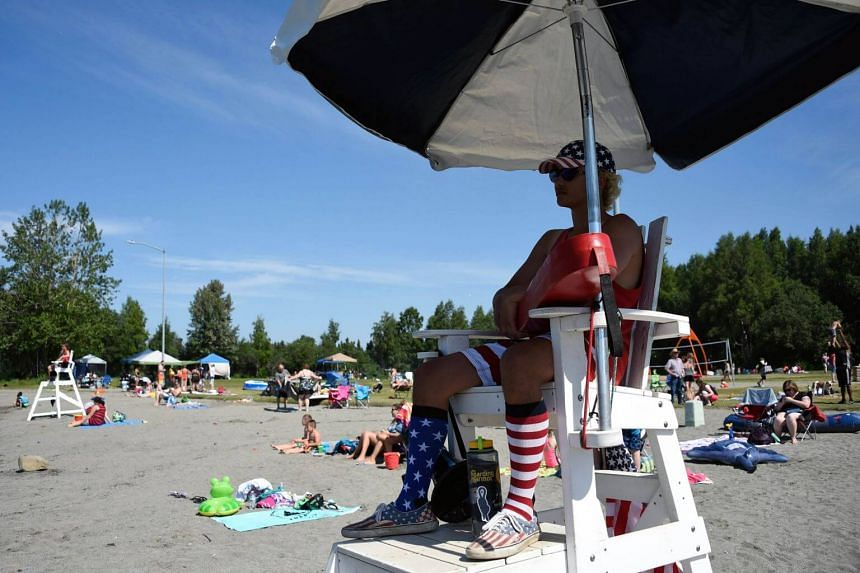 A lifeguard watches on at Jewel Lake on July 4, 2019 in Anchorage, Alaska.