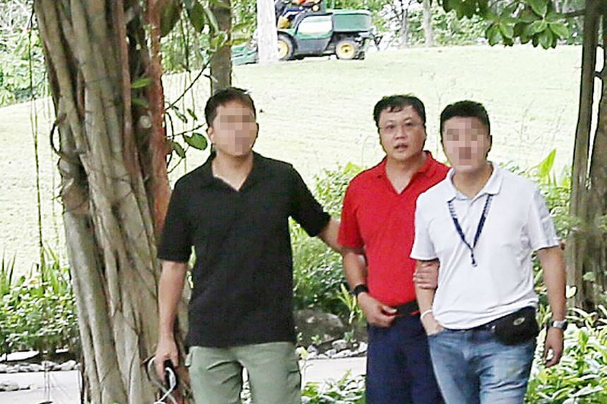 Khoo had reason to kill Ms Cui (above), who was pressing him to repay a $20,000 debt to her. The victim's burnt and decomposed remains were found at Lim Chu Kang Lane 8. Leslie Khoo Kwee Hock (in red) being led to the crime scene at Gardens by the Ba
