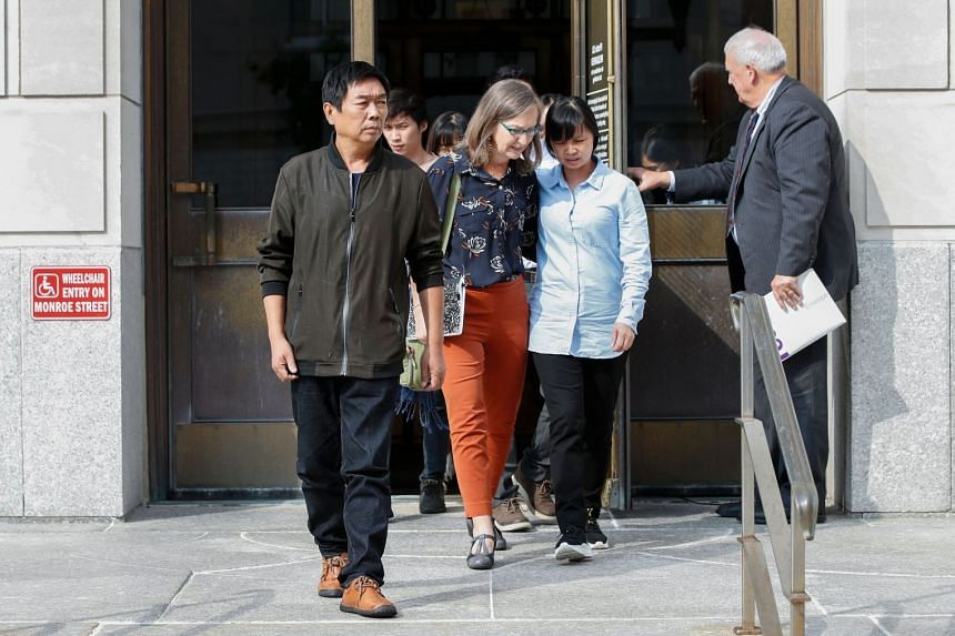 The victim's father, Zhang Ronggao (left), and mother, Ye Lifeng (second right), leave court on July 8, 2019.