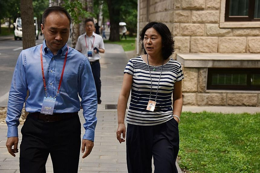 Chinese Foreign Ministry spokesman Hua Chunying (right) on the campus of the Central Party School during a government-organised tour for foreign journalists in Beijing last month. She has urged officials to make use of foreign social media platforms
