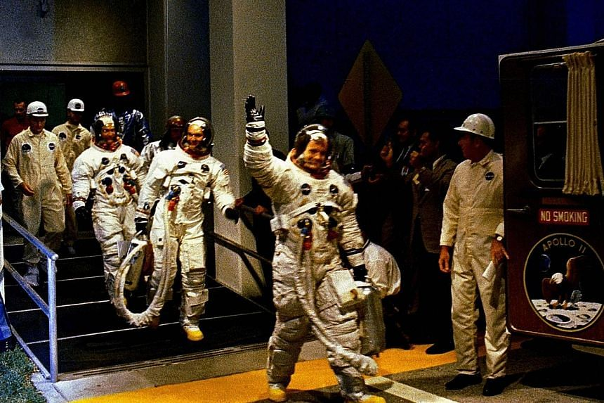 The crew leaving the manned spacecraft operations building during the pre-launch countdown.