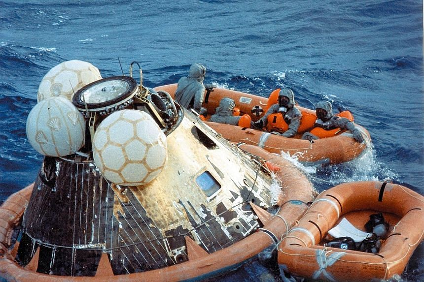 The astronauts waiting to be picked up during recovery operations in the Pacific Ocean on July 24, 1969.