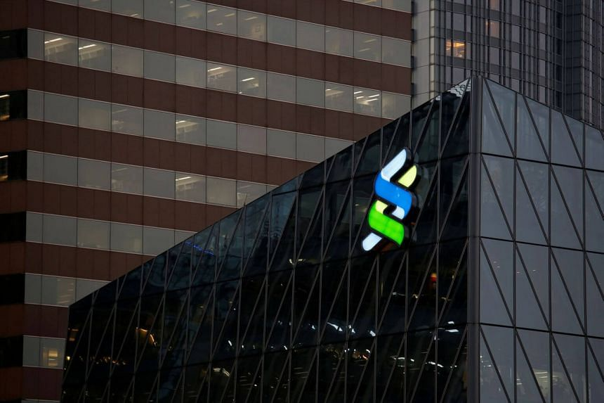 The whistle-blower claims Standard Chartered's wrongdoing was more extensive than the US alleged and seeks an order forcing it to pay an unspecified additional sum to the government.