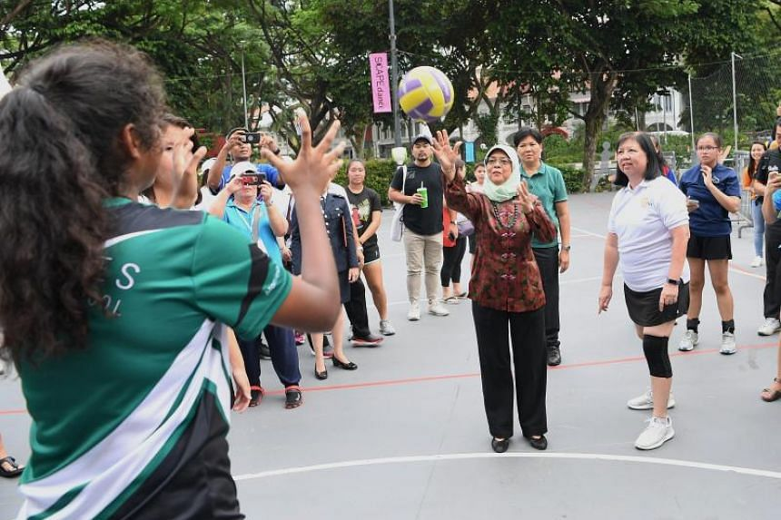 President Halimah Yacob participates in a friendly netball match, one of the activities held at *SCAPE on July 20, 2019, in support of the President's Challenge Volunteer Drive 2019.