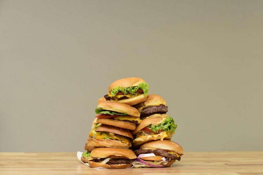 The Straits Times conducted a blind taste test of the good old cheeseburger from 12 burger-centric restaurants in Singapore.