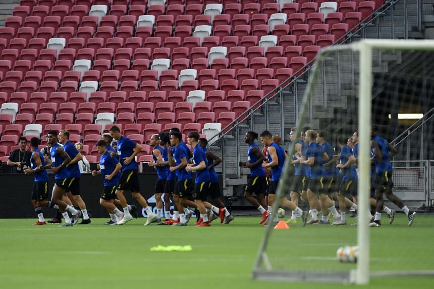 Manchester United's players warm up during a training session in Singapore on July 19, 2019, ahead of their International Champions Cup football match against Inter Milan.