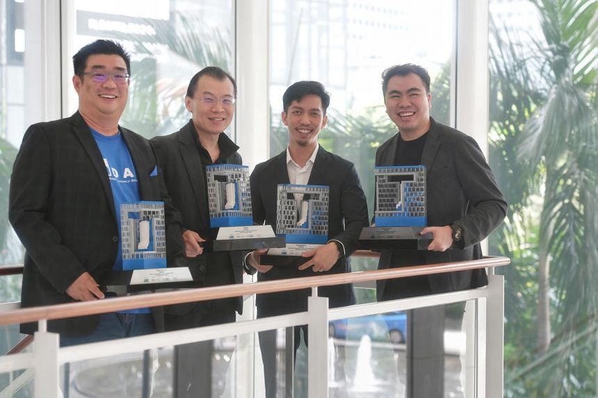 (From left) M-DAQ chief executive Richard Koh, ViSenze CEO Oliver Tan, ThoughtWorks' South-east Asian head of operations and finance Wong Wen Shun and Web Imp's business director Wilson Tan with their firms' awards for Best Tech Companies to Work For