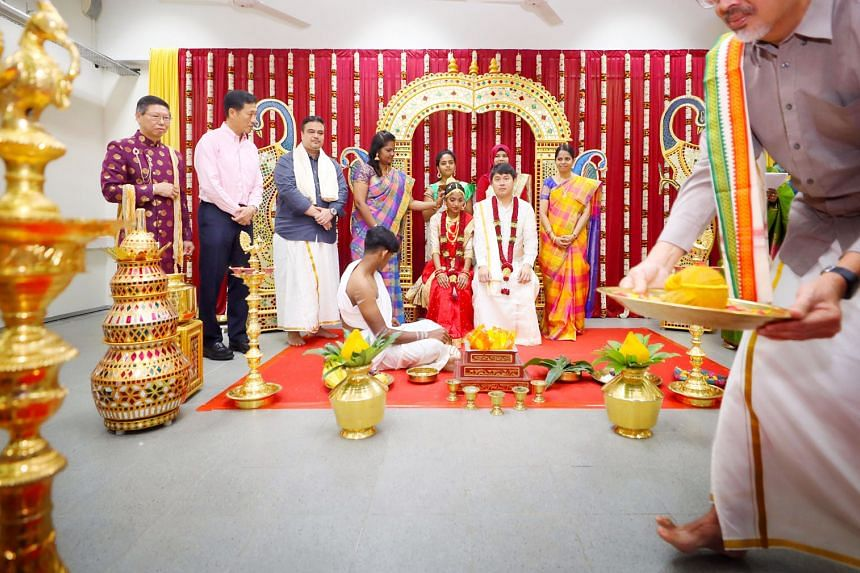 Mock Indian (above), Malay and Chinese wedding ceremonies being performed by the staff and students of Chua Chu Kang Secondary School in celebration of Singapore's diversity, with Minister for Education Ong Ye Kung (above, left) looking on.
