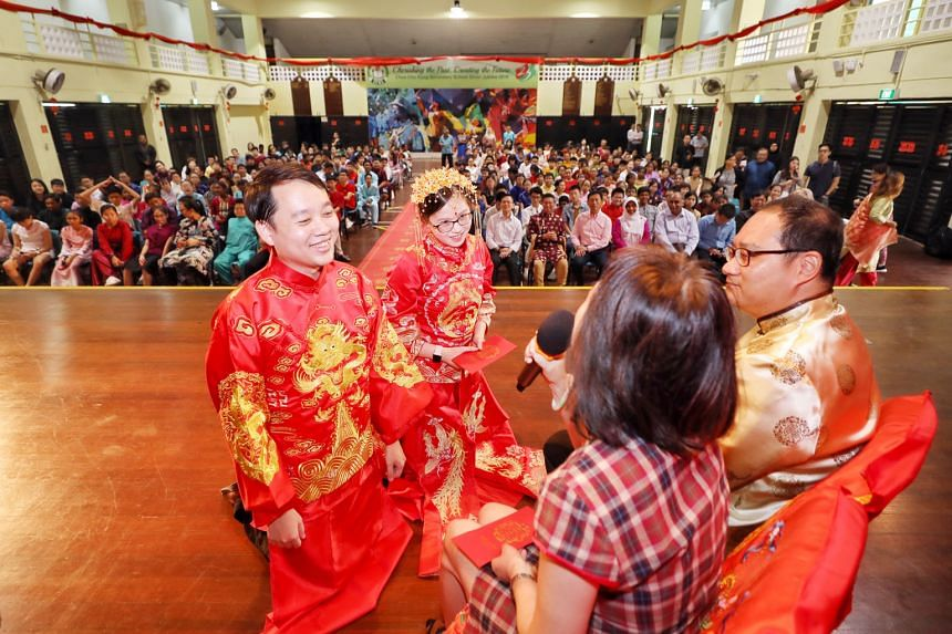 Mock Indian, Malay and Chinese (above) wedding ceremonies being performed by the staff and students of Chua Chu Kang Secondary School in celebration of Singapore's diversity, with Minister for Education Ong Ye Kung looking on.