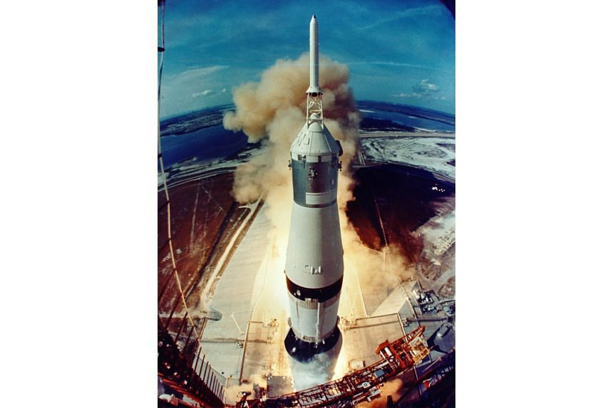 The Apollo 11 crew on a Saturn V rocket lifting off from the Kennedy Space Centre in Florida on July 16, 1969.