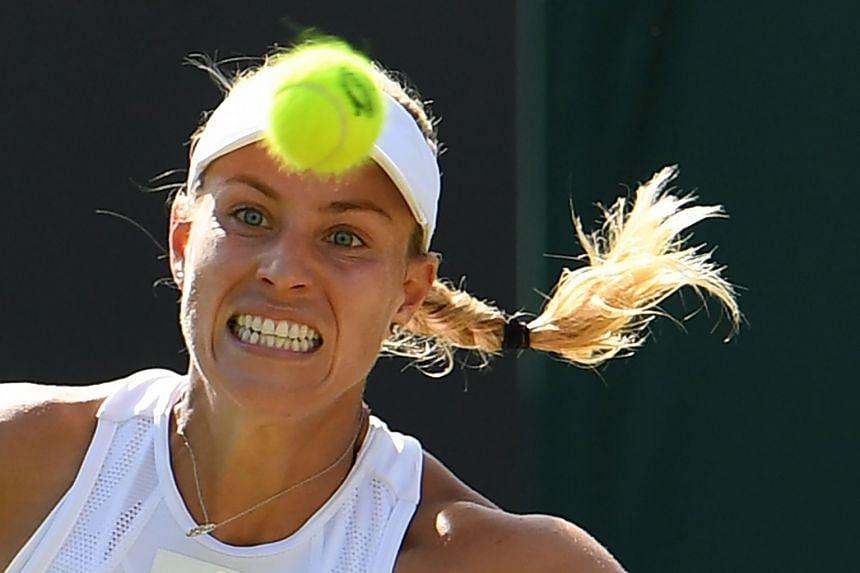Kerber returns against US player Lauren Davis during their second-round Wimbledon match.