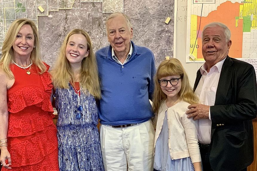 "(From left) The writer, her daughters and husband with Mr T. Boone Pickens (centre), 91, the last living old-school oil tycoon, who made his fortune as a ""wildcatter"" – hunting for oil in unproven soil."