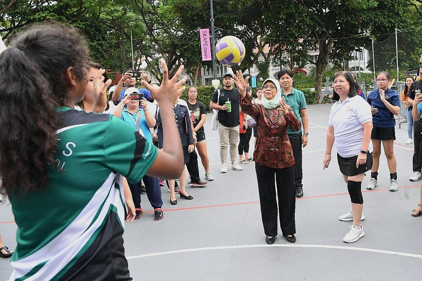 President Halimah Yacob taking part in a netball game at an event in support of the President's Challenge Volunteer Drive 2019 at *Scape yesterday. The President's Challenge has rallied over 6,000 volunteers since the start of the year, more than 80