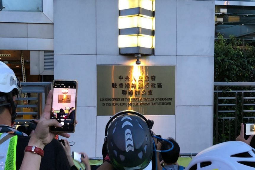 The name plaque of the China Liaison Office is seen after eggs were thrown at it by protesters, in Hong Kong on July 21, 2019.