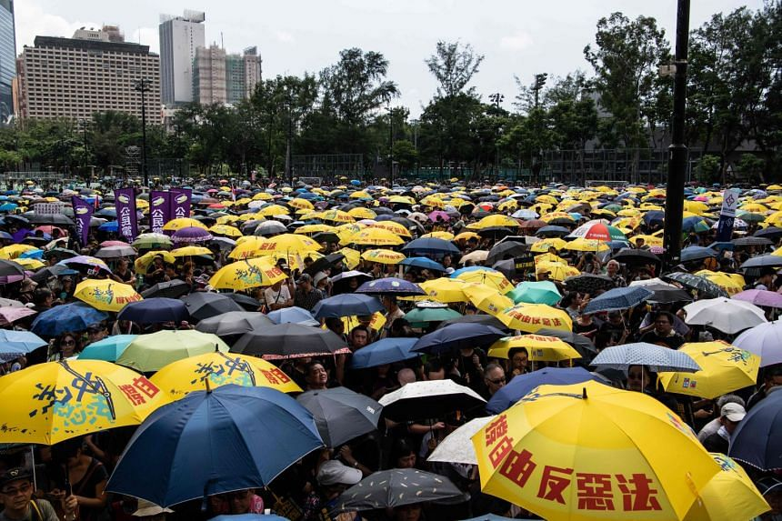 Protesters gathering at Hong Kong's Victoria Park to participate in an anti-government march in Hong Kong on July 21, 2019.