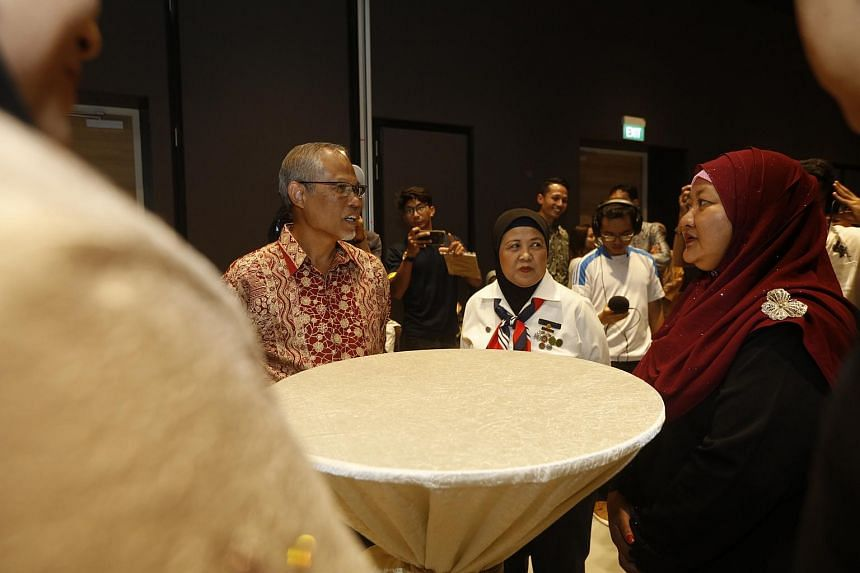 Minister-in-charge of Muslim Affairs Masagos Zulkifli speaking to individuals who were recognised as part of the #InspirasiSG campaign, at an event in Wisma Geylang Serai on July 21, 2019 .
