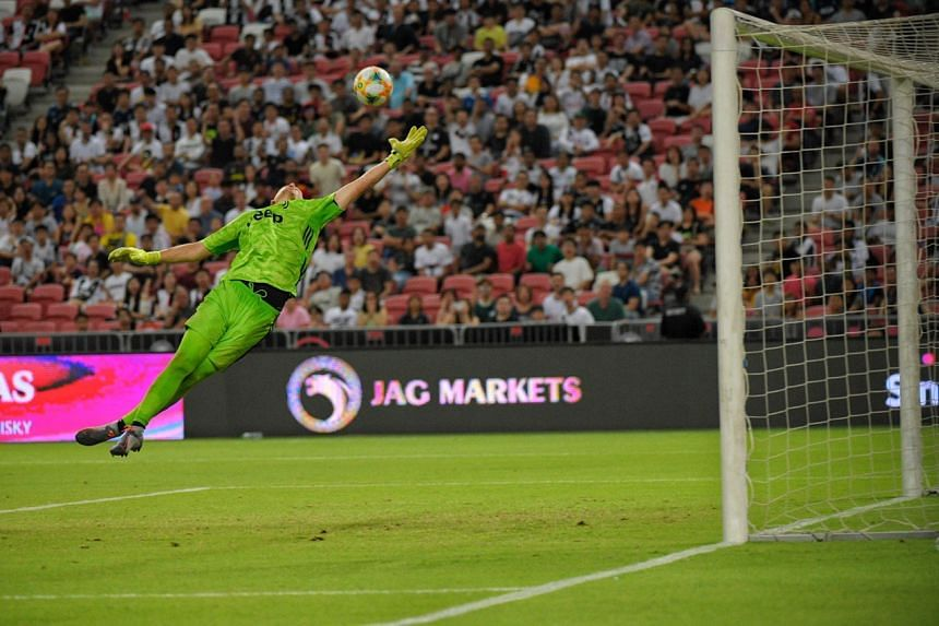 Juventus keeper Wojciech Szczesny attempting to reach for Tottenham Hotspur striker Harry Kane's shot late in stoppage time, during the International Champions Cup match on July 21, 2019.