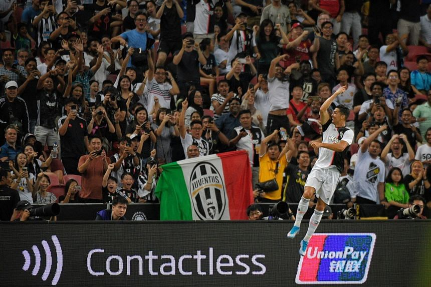 Juventus' Cristiano Ronaldo celebrating in front of the fans after scoring against Tottenham Hotspur during their International Champions Cup match on July 21, 2019.