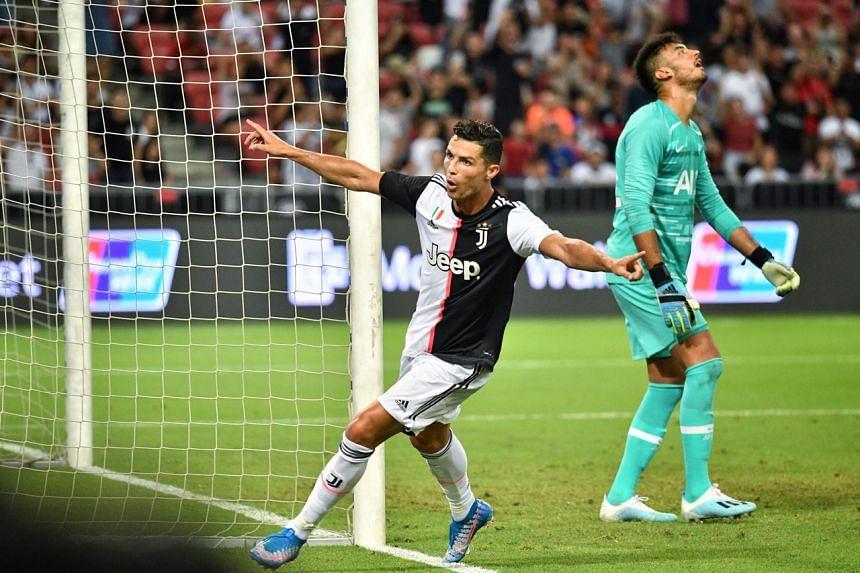 Juventus' Cristiano Ronaldo celebrating after scoring his team's second goal against Tottenham Hotspur on July 21, 2019.