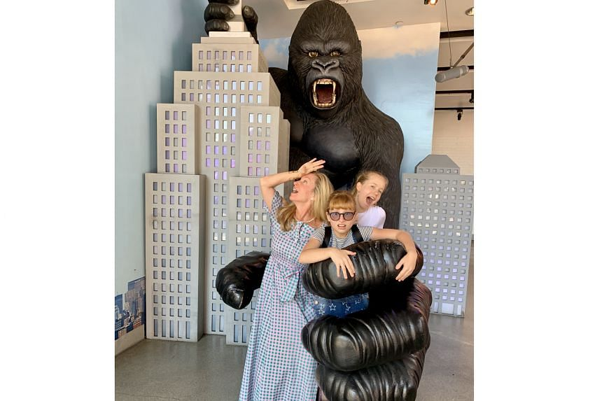 The writer and her daughters get to grips with King Kong at Madam Tussauds Hollywood.