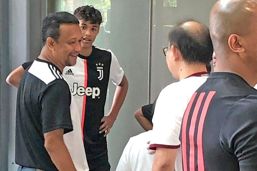 Fandi Ahmad, with his son Ilhan, speaking with fans before another meet-and-greet with Juventus players Miralem Pjanic and Mattia de Sciglio.