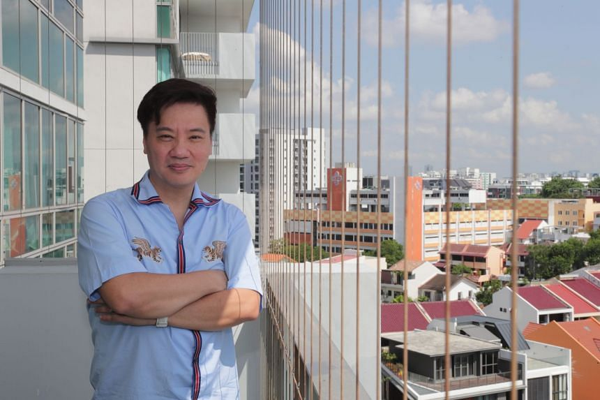 The balcony of Mr Gan's unit overlooks an enclave of landed properties, and his family enjoys spending time working and dining there.