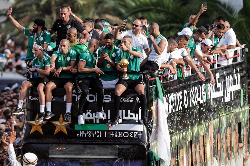 Algerian national soccer team players celebrate with thousands of supporters in Algiers.