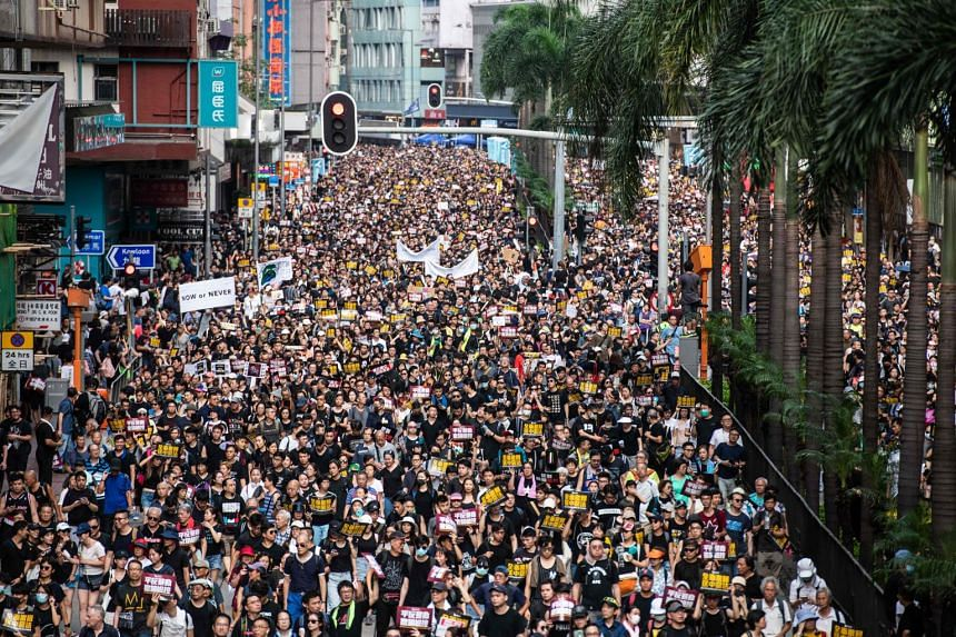 Protesters march against a controversial extradition Bill in Hong Kong on July 21, 2019.