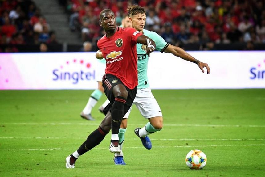 Manchester United's Paul Pogba attempts to shake off Inter Milan's Longo.