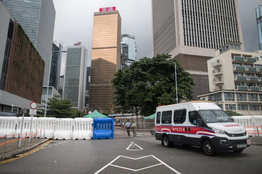 Water barriers are set up on a road leading to the Central Government Offices in Admiralty, Hong Kong, China, on July 20, 2019.